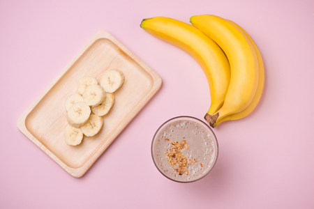 Banana Smoothie on a yellow background. Selective focus