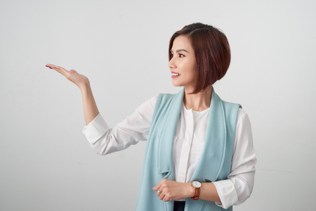 Business Woman presenting Product on her hand Isolated On White Background. Stock fotó