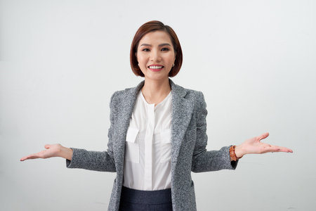 Happy inspired businesswoman dressed in office clothes looking at the camera surprisingly and smiling open arms on white background Фото со стока