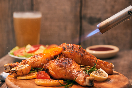 Chef cooking of Crispy Fried Chicken on wooden board background in the restaurants. Foods concept. Warm lights tone. Stock Photo - 116702040