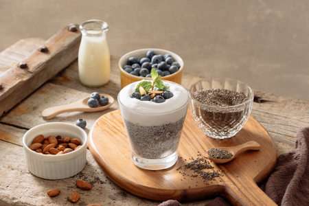 Chia pudding with berries and milk, sweet nourishing dessert, healthy breakfast superfood concept Stock Photo
