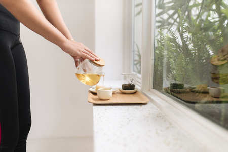 Happy young asian woman tea near window in the morning