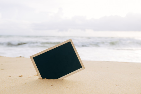 Net board for your text on a summer background in the sand.