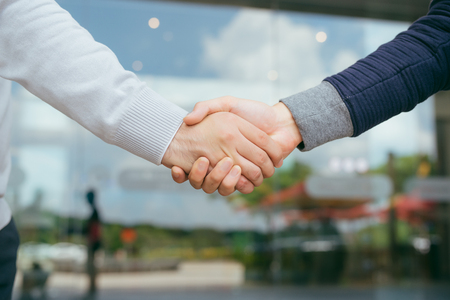 Portrait of successful mid adult partners shaking hands Stock Photo