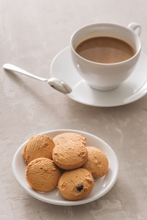 White cup of creamy coffee with butter cookies and stainless teaspoon isolated on white background, clipping path Stock fotó - 117404896