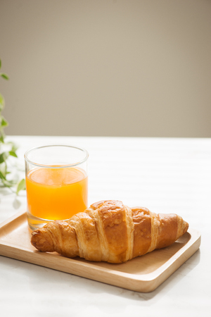 Morning breakfast with croissant and fruit juice Banco de Imagens