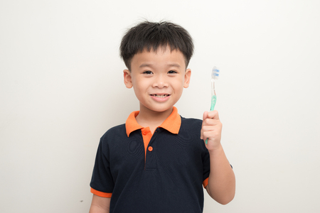 Handsome Young Boy Brushing Teeth Stock Photo - 117421537