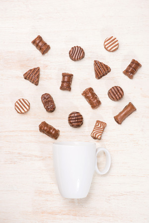Glass of chocolate milk and variety chocolates  on table Stock Photo - 118050419