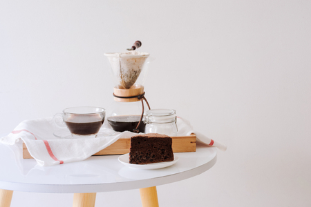 Breakfast with chocolate cake and coffee served on a beautiful living home 스톡 콘텐츠