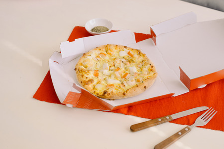 Lunch time, pizza in a open box on table