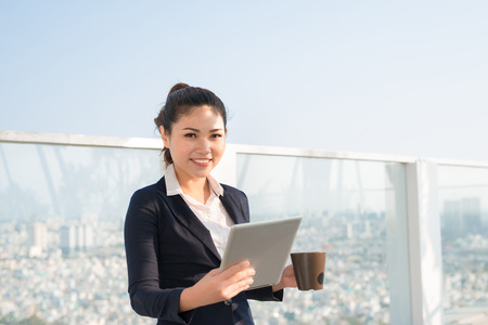 Portrait of smiling business woman using tablet pc