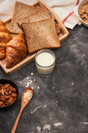 Breakfast with toast and croissant. milk in a glass bottle. Good start to the day. Good morning Фото со стока