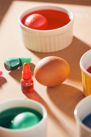 A dozen eggs in a carton, used watercolor paints. Reklamní fotografie