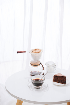 Drip coffee (dripper) and drip ground coffee with glass drip pot, cup and chocolate cake Stock fotó