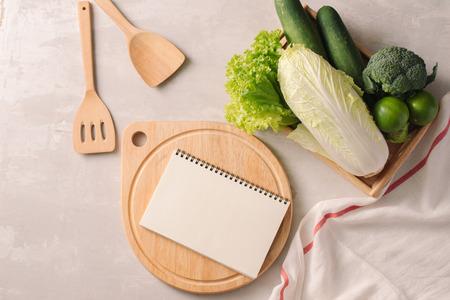 Fresh vegetables in wooden tray. Healthy food ingredients. Organic farmer vegetables. Top view.