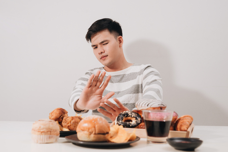 Young man in dieting and healthy eating concept 免版税图像
