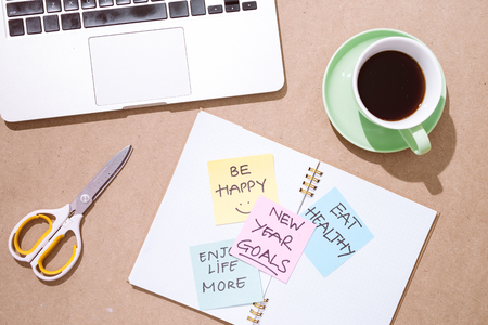 colored paper stickers with business strategy and laptop on tabletop