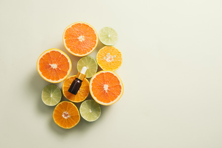 Brown Bottle with lemon, orange, tangerine and vitamin C. on white background. Stockfoto