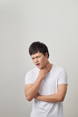 Man has a terrible pain in throat because of flu. He lost his voice and can not speak Banco de Imagens
