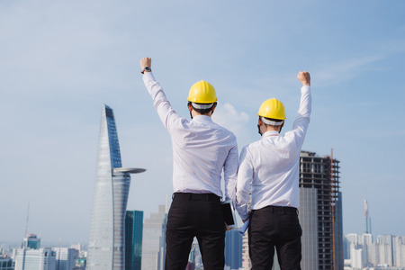 Engineer hands up in construction site Фото со стока