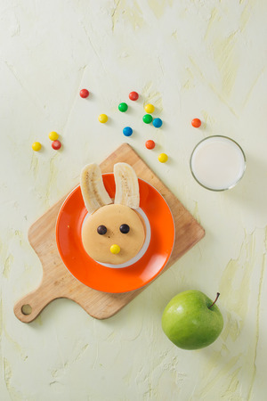 Funny bunny pancakes with fruits for Easter kids breakfast