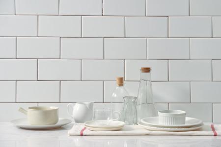 Kitchen shelf full of various utensils isolated on white background 免版税图像