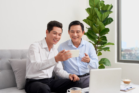 Two businessmen are working in office.Business concept.