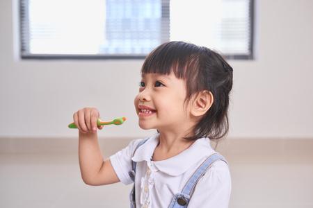 dental hygiene. happy little girl brushing her teeth Stock Photo