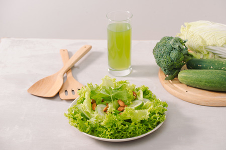 Various green organic salad ingredients on white background. Healthy lifestyle or detox diet food concept