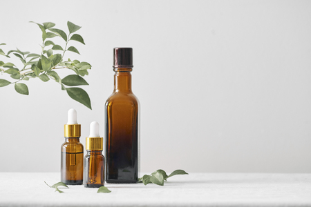 Bottles with aroma oil, medicines on wooden background. Selective focus,horizontal. Stock Photo