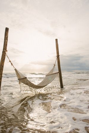 Tropical chilling out - hammock in turquoise water. 版權商用圖片