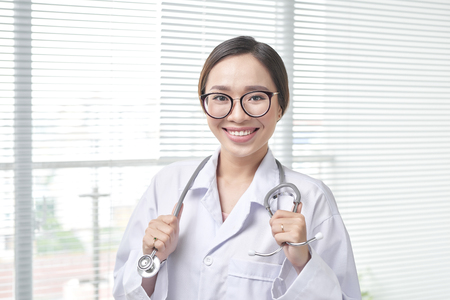 Health care friendly professional worker. Patient visit. 写真素材