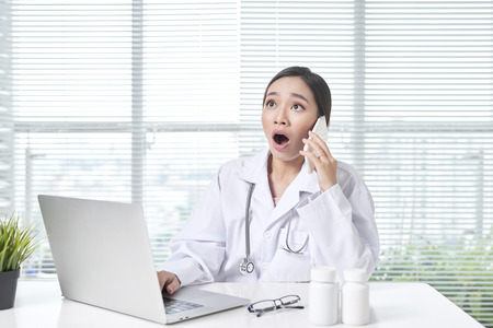 woman medical staff calling coworker nurse to ask problem of patient. 写真素材
