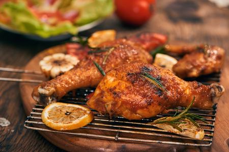 Grilled bbq chicken with fresh herbs and tomatoes