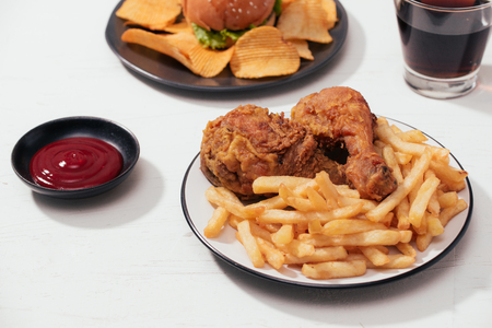 Fast food hamburger with set fried crispy chicken and french fries, ice cola on the side Banco de Imagens