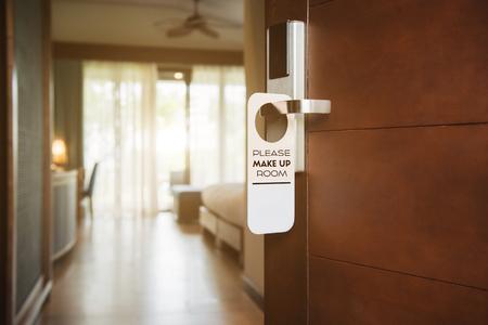 Make up room sign hanging on door handle