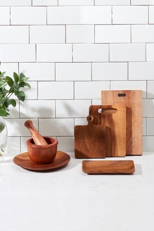 Still life with kitchen wooden utensils on white background Stock Photo
