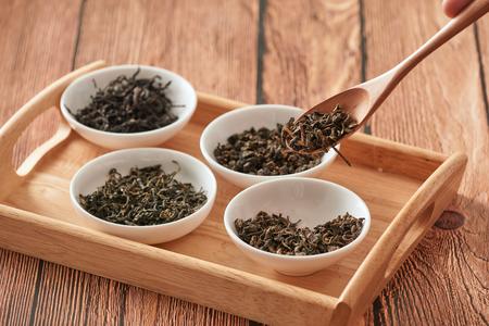 Green tea on wooden spoon Reklamní fotografie