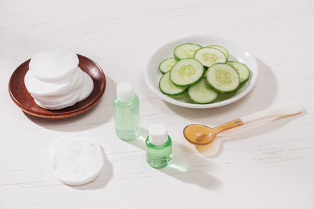 Cosmetic bottle and fresh organic cucumber for skincare. Home spa concept.