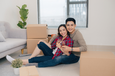 Just married couple of young man and woman feeling unbelievable chilling in their new house