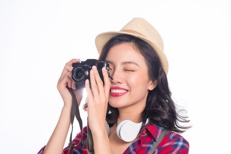 Woman travel. Young beautiful asian woman traveler taking pictures on white background