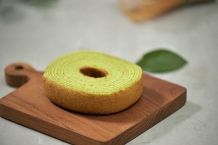 Close up on green matcha Baumkuchen Japanese roll cakes, selective focus Stock Photo