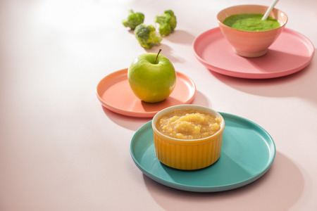 Natural baby food concept. Different types of vegetable puree on the light background
