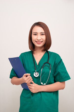 Asian nurse woman with a folder , isolated on white background