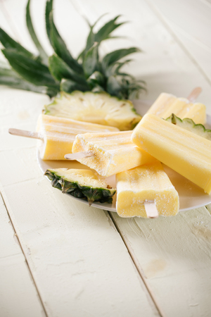 Homemade popsicles made of pineapple