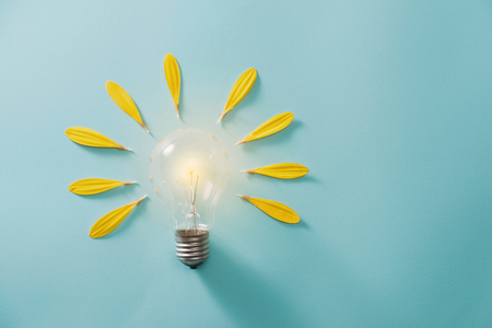 Creative idea, Inspiration concept with light bulb on blue background