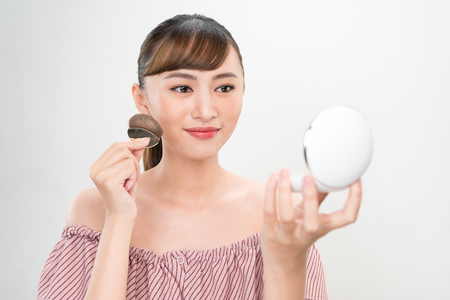 Beautiful Female With Cushion Puff And Mirror Applying Makeup Powder Foundation Stock Photo