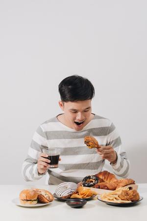 People eating fast food concept hand holding deep fried chicken carbonated soft drink Reklamní fotografie