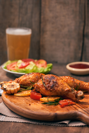Chicken drumstick in on wood board Stock Photo
