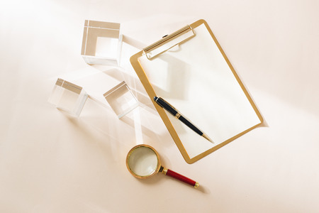 White Desktop. Mock up product view table gold accessories. stationery supplies. glamour style. Gold stapler 스톡 콘텐츠